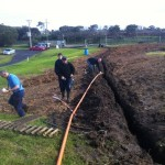 Trench dug and cables being installed