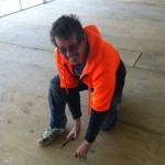 Peter removing staples from floor